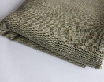 Wool mix suiting green/cream herringbone weave