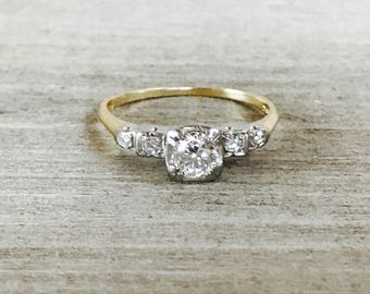 Diamond solitaire in 14k yellow and white gold