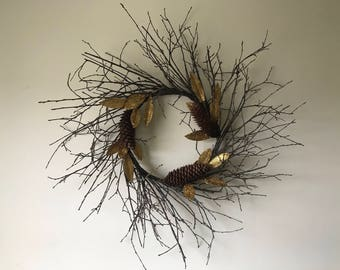 Twig wreath with golden leaves