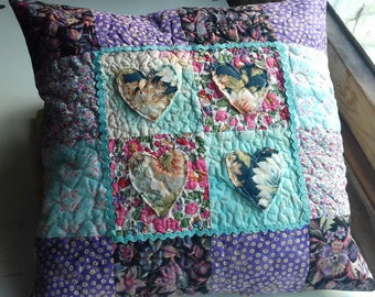 Shabby chic, vintagestyle patchworked and quilted cushion cover
