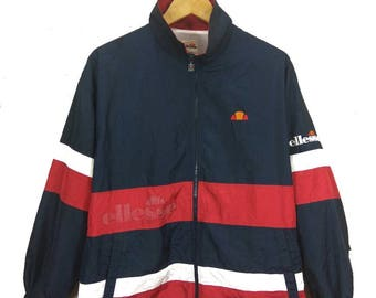 RARE! Vintage ELLESSE Small Embroidery Logo and Spellout Windbreaker Jacket. Dark blue, Red Colour.