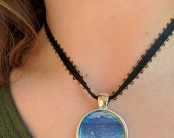 hand painted under water scene pendant on black ribbon