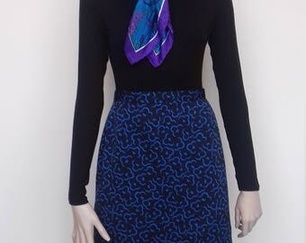 Black pencil skirt with a blue floral pattern - size 12/14