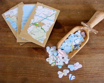 Map heart confetti in individual envelopes. Wedding/party heart confetti. Mini envelopes containing heart map confetti.