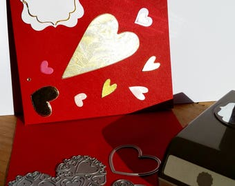 A square red greeting card, handmade, handcrafted, embellished.