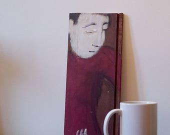 Painting on wood, decorative gift - character head down on red background