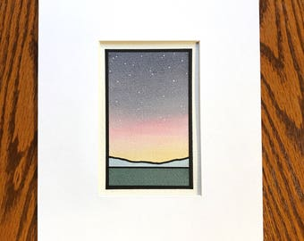 Subtle sunset with stars, field and mountains