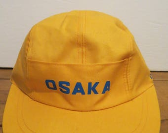 OSAKA BATTERY Cap Hat Yellow Pocket Pouch To Front Japan Stretch Elastic RARE!
