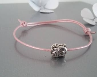 Pink leather adjustable bracelet with a Buddha head bead