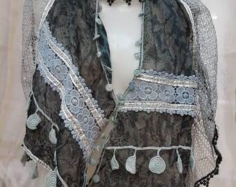 Design with applique shawl