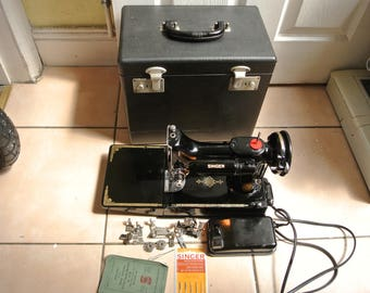 Singer 221K Featherweight Sewing Machine with attachments & instruction manual