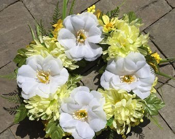 White hibiscus, yellow mum wreath