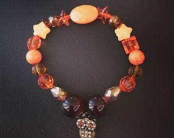 Orange beaded owl bracelet