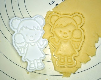 Girl Holding Ice Cream Cookie Cutter and Stamp