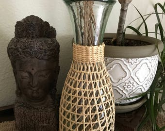 Boho vintage glass carafe wrapped in straw