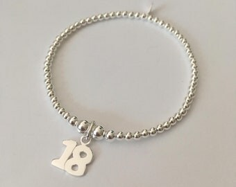 Sterling Silver stretch bracelet with '18' charm