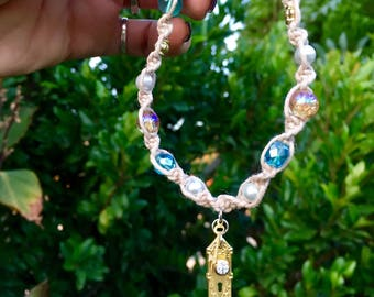 Alice in wonderland themed hemp bracelet with blue, white and golden glass beads and gold tone doorknob and key charm