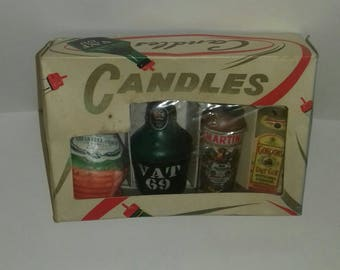 Set of 4 vintage candles in original box.