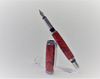 Fountain pen made of ash maser wood stabilized with red acrylic