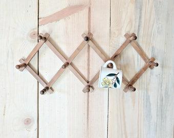 vintage accordion wood peg wall rack | wooden hanging hook rack