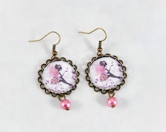 boucles d'oreilles fée rose papillon rétro