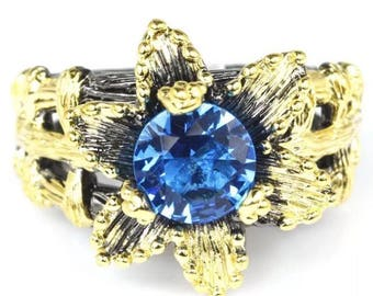 Stunning Blue Topaz Black Gold Ring with Brushed Gold