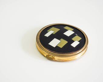 Metal gold black pocket mirror.
