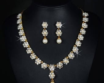 Gold crystal and pearl bridal necklace and earrings