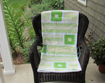 Soft and warm cotton flannel baby quilt, grass green, soft yellow, and white.
