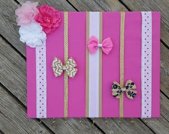 Pink bow and headband holder
