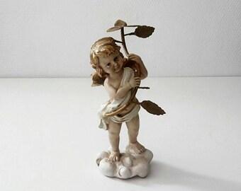 Cherub/Angel made of molded plastic, hand painted. Vintage