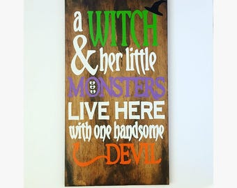 A witch and her little monsters live here with one handsome devil, fall decor, Halloween decor, signs for fall, signs for halloween