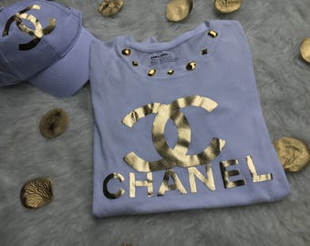 Chanel Inspired Gold and White Embellished T-Shirt with Chanel Inspired Gold Baseball Hat Collection