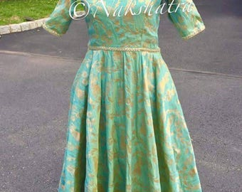 Pista green raw silk long frock with cold neck shoulders