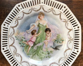Pastel coloured hand painted collectible plate