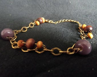 Brass bracelet with purple and wooden beads