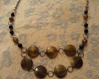 Vintage Black Metal Beaded Necklace With A Circular Gold Swirl Beaded 2 Strand Bib.