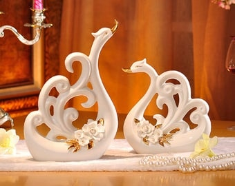 Pair of White Porcelain Swans with Decorative Wings