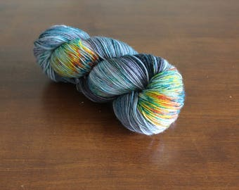 Handdyed yarn, sock yarn, fingering weight, yarn, socksanity, socksanity kukulkan, purple, blue, orange, yellow