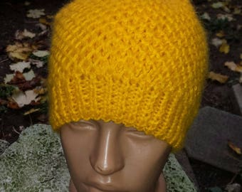 Hat knit by hand with white tassel