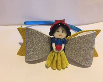 Adorable  headband with Snow White made with cold porcelain (without mold).