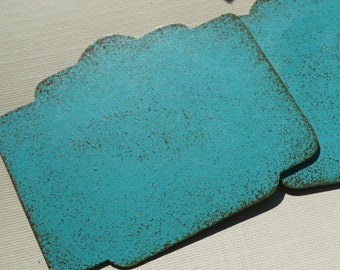 Three Blue Distressed Metal Embellishments 2 3/4 inches Wide