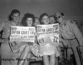 Glossy Reproduction photo of WW ll Photo of People Reading A newspaper Japan Gives Up