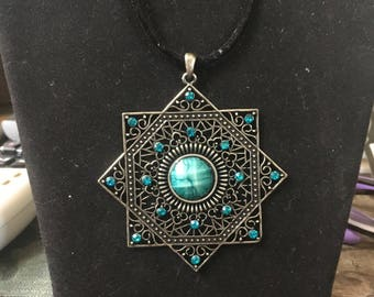 Green and black necklace and pendant