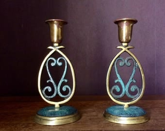 2 bronze candlesticks.