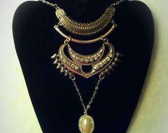 This one of a kind necklace has a faux perl and diamonds