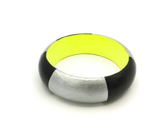 Handmade  bright wooden statement bangle in black, silver and neon yellow
