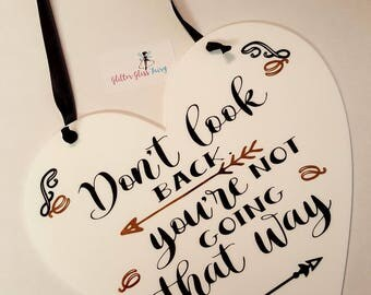 Large hanging heart sign. Don't look back, you're not going that way motivatuonal quote gift.