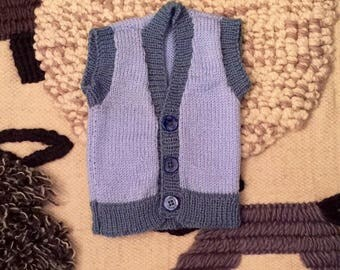 Hand knitted woollen baby and toddler vests