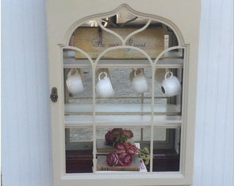 Beauty and the Beast inspired Hutch for storage and display. Painted in sandbar with natural wood interior and new shelves; Fully restored